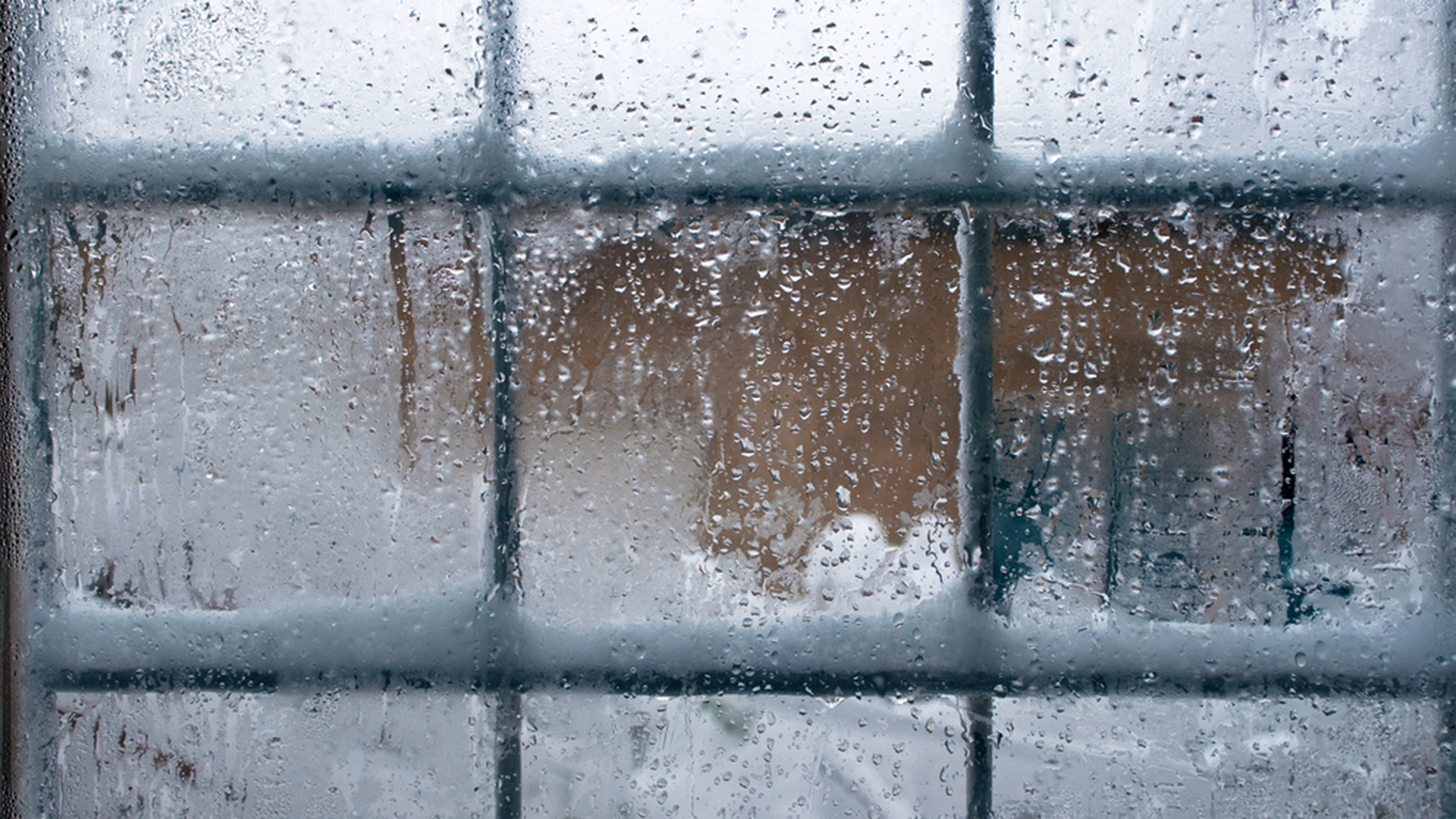 Winter window, drops of water and snowflakes on a window pane.; Shutterstock ID 122111422; PO: david-today